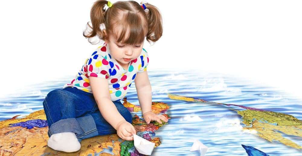 Prepare-child-move-overseas-Little-girl-on-large-map