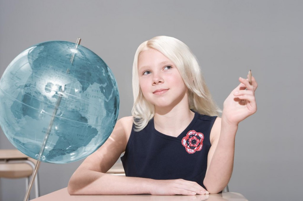Choosing a boarding school for child of overseas expat parentsBlonde girl with globe