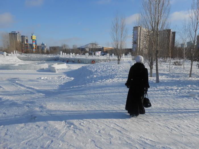 Woman in snow in Kazakhstan