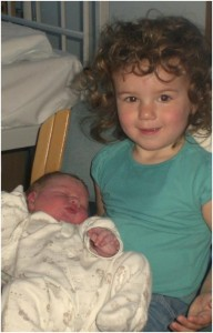 Newborn baby and her big sister.