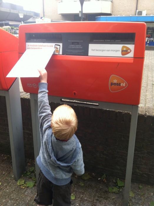 Boy posting a letter