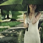 Expat reverse culture shock repatriation Woman standing under an umbrella in the rain