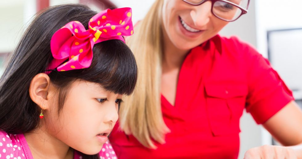 Private tutor girl and tutor working at home Kings Tuition