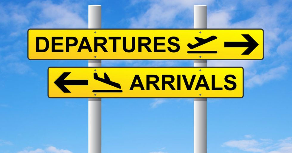 Departures and arrivals signpost